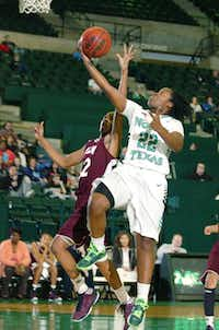 North Texas guard BreAnna Dawkins, right, moves in to score against Louisiana-Monroe guard Alexar Tugler last Saturday at the Super Pit. Today, UNT will play host to South Alabama.DRC/David Minton