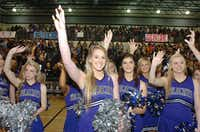 Guyer cheerleaders make the wildcat claw hand sign while singing the alma mater at the end of the community pep rally Friday morning.Al Key - DRC