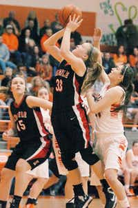 Argyle guard Jesse Sheridan, center, puts up a shot against Celina on Friday in Celina.DRC - David Minton