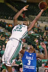 North Texas guard Jordan Williams, left, stretches out over Middle Tennessee senior James Gallman Jr. to grab a rebound Thursday at the Super Pit.DRC - David Minton