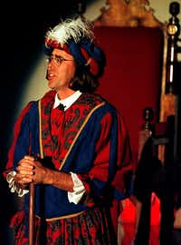 Neal Smatresk, then the chairman of the biology department at the University of Texas at Arlington, gamely portrayed the Lord Chamberlain for the UTA's Feast of Carols during the holidays in 1997.Arlington Morning News file photo