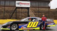 Corinth racer Cole Glasson stands with the No. 00 Ford of Andy Ponstein Racing recently at Anderson Motor Speedway in Williamston, S.C. Glasson, 12, was invited to test for the team and plans to race this season on the JEGS/Champion Racing Association All-Stars Tour.Courtesy photo