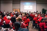 Attendees watch a presentation at the Go Red for Women Luncheon and Fashion Show on Friday at the UNT Gateway Center.David Minton - DRC
