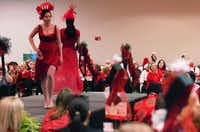 Models walk the stage at the Go Red for Women Luncheon and Fashion Show on Friday at the UNT Gateway Center.David Minton - DRC