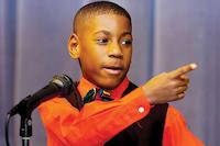 Rivera second-grader Elijah Thomas does an impersonation of Dr. Martin Luther King Jr. on Friday during the celebration.DRC / Al Key
