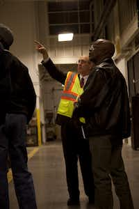 Denton County Transportation Authority president Jim Cline talks to members of the Southeast Denton Neighborhood Association during a recent tour of DCTA's new bus maintenance and operations facility.Bj Lewis - DRC