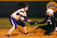 Denton's Jessica Juarez, left, tags out Guyer's Kaitlyn Thomas at second base Friday.DRC - David Minton