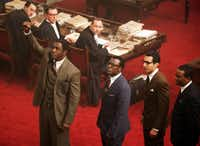"Standing, from left, are Idris Elba as Nelson Mandela, Tony Kgorge as Walter Sisulu, Riaad Moosa as Ahmed Kathrada and Thapelo Mokena as Elias Motsoaledi in ""Mandela: Long Walk to Freedom.""The Weinstein Co."