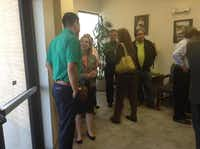 Guests visit with each other at a ribbon cutting ceremony for the new offices of United Way, located at 1314 Teasley Lane in Denton on Wednesday.Courtesy photo