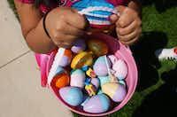 Plastic eggs, bubblegum and suckers fill a basket after Saturday's Easter egg hunt at Quakertown Park.David Minton - DRC