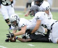 Anthony Taylor tries to recover his own fumble with Thomas Ferguson (21) during Guyer High School spring football game, Thursday, May 23, 2013, in Denton, TexasMatt Strasen - Chronicle