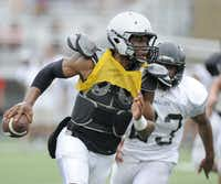 Jerrod Heard looks for running room during Guyer High School spring football game, Thursday, May 23, 2013, in Denton, TexasMatt Strasen - Chronicle