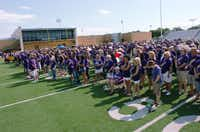"Hundreds of Denton High School alumni gather at Bronco Field in June for the filming of scenes for ""When We Were All Broncos.""David Minton"