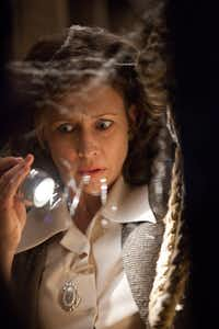 "Lorraine Warren (Vera Farmiga) tries to hunt down the source of strange goings-on in ""The Conjuring.""New Line Cinema - Warner Bros."