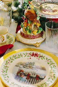 """Holly-ringed plates picturing a mailbox full of goodies and a plump ceramic partridge: It all says the holidays are near. See this table setting and others at """"Tea & Trumpets,"""" a holiday-themed fundraiser presented by the Denton Benefit League.David Minton"""