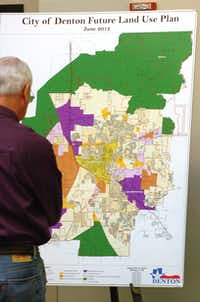 A Denton resident checks out a map showing the city's future land use plan at a community forum to discuss the Denton Plan 2030 comprehensive plan to determine future zoning and land use in Denton, Thursday, November 1, 2012, at the LaGrone Advanced Technology Complex in Denton, TX.David Minton