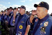 Army veteran Lupe Martinez, right, salutes with other veterans as taps is played at the end of the Veterans Day of Remembrance on Friday in Krum.Al Key - DRC