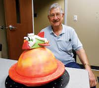 "Don Davis, owner of David Purity Bakery, shows off ""Out of This World,"" his bakery's winning entry in the University of North Texas' recent cake decorating contest.Courtesy photo"