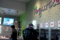 Customers try flavors at the new Yogurtland at Sterling Fry Street, which opened its doors last week.Courtesy photo