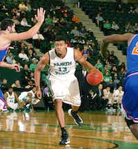 North Texas' Tony Mitchell drives the ball against UTA on Wednesday.DRC/David Minton