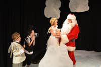 "The angels and Santa embrace the smallest angel in the play ""The Littlest Angel,"" the Denton Community Theatre's Theatre School production at PointBank Black Box Performing Arts Center. Shown, from left, are the Second Angel (Landon Nace), the Fifth Angel (Mekhi Chapa), the Littlest Angel (Maddee Young) with Pickles the Bear and Santa (Steve Hindman).DRC"