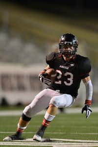 Argyle's Chance Bode runs after making a catch Friday during a Class 3A Division II regional semifinal against Gilmer in Mesquite. Gilmer won 42-21.For the DRC/Michael Clements