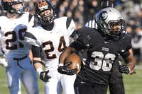 Guyer running back Richard Whitaker, right, carries the ball for a touchdown against Aledo on Nov. 23 in Justin.Mike Mezeul II - For the DRC