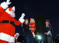 Santa Claus meets young Avery Winters, last year's official tree lighter, before she throws the switch at the 2012 Denton Holiday Lighting Festival.David Minton - DRC file photo