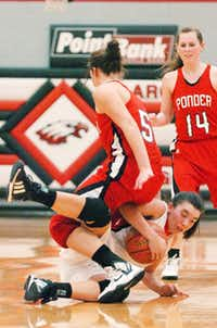 Ponder guard Madison Stout (5) falls over Argyle guard Kim Strelke on Friday in Argyle. Stout scored 21 points, but Argyle won 47-37.DRC/David Minton
