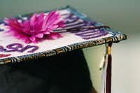 Texas Woman's University graduate Caitlin Criswell decorated every inch of her mortarboard for the commencement ceremony at Kitty Magee Arena on Friday in Denton.David Minton - DRC