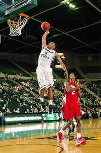 North Texas sophomore guard Chris Jones, left, goes up for a dunk against Louisiana-Lafayette on Dec. 1 at the Super Pit.DRC/David Minton