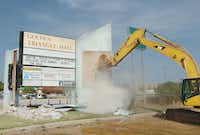 The sign at Golden Triangle Mall comes down Aug. 2 after 33 years of service in Denton.Al Key - DRC file photo