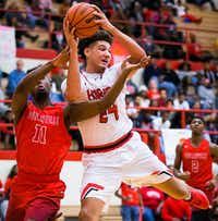 Cedar Hill center Zach Simmons (24) is one of the top recruits in Texas this season and could make a big impact for North Texas next fall.<p>The Dallas Morning News/Smiley N. Pool</p><p></p>