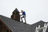 "<p><span style=""font-size: 1em; background-color: transparent;"">Freddy Murphy, a project manager at Linear Roofing and General Contractors LLC in Dallas, examines hail damage on a roof at a home in the 300 block of Collins Street on Monday in Argyle. Many homes in southern Denton County suffered roof caused by Sunday night's thunderstorms that brought with it hail up to the size of softballs. Denton County officials have reported no major injuries related to the storms.</span></p>DRC/Julian Gill"