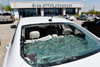 "<p><span style=""font-size: 1em; background-color: transparent;"">This 2016 Ford Fusion at Bill Utter Ford in the 4900 block of South Interstate 35E in Southeast Denton took some of the worst hail damage from Sunday night's thunderstorm. It is just one of the 450 to 500 cars and trucks that received hail damage. Most of the damage were dents and dings in the meta</span></p>For the DRC/Barron Ludlum"