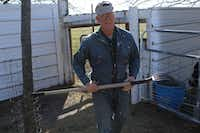 Shorty Brunk uses a pitchfork to transport hay from the bale to the donkey enclosure.For the DRC/Madison Wilson