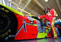 Dale Earnhardt Jr., driver of the #88 Axalta Chevrolet, climbs into his car during practice for the Monster Energy NASCAR Cup Series O'Reilly Auto Parts 500 at Texas Motor Speedway on Saturday in Fort Worth. Jonathan Ferrey/Getty Images