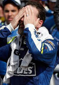 NASCAR driver Jimmie Johnson uses a damp towel to cool down after winning the O'Reilly Auto Parts 500 on Sunday at Texas Motor Speedway in Fort Worth.Brandon Wade/Fort Worth Star-Telegram