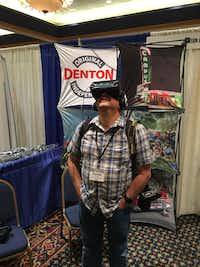 Texas Department of Transportation photographer Michael Amador immerses himself in a virtual visit to Denton on Tuesday during the 2017 Texas Travel Fair at the TxDOT Travel Information Division's annual Travel Counselors Conference in Amarillo.Kim Phillips/Denton Convention & Visitors Bureau