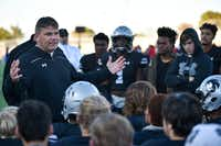 Guyer head coach John Walsh talks to his team following a game last season. New NCAA rules could impact the recruiting calendar and the possibility of high school coaches making the jump to college.DRC/Jeff Woo