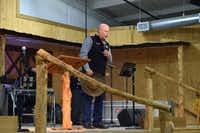 Jamie McClain, associate pastor of Denton County Cowboy Church in Ponder, begins Sunday service by leading the congregation in prayer.Sarah Sarder/For the DRC
