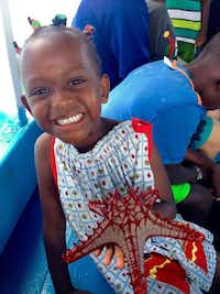 A Haitian girl on a bus wears one of the dresses made by the Southmont Baptist Church ministry Dress a Girl.Courtesy photo