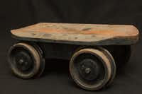 """<p><span style=""""font-size: 1em; background-color: transparent;"""">This solid metal trolley was once used to help move massive rolls of newsprint for the press that used to print the <i>DRC</i>. Former photographer David Minton uncovered this find, but watch your toes -- it weighs several hundred pounds.</span></p>"""