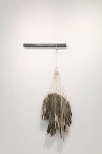 """In a solo show at Brick Haus Collective, artist Delaney Smith plays with the ideas of tension and balance.   """"Through The Woods,"""" 2016. Cotton, nylon and steel.  22 inches by 44 inches by 5 inches.Courtesy photo"""