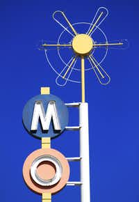 This Thursday, May 11, 2017, photo shows one of the neon signs that has been refurbished along Route 66 in Albuquerque, N.M. University of New Mexico associate dean and architecture professor Mark Childs pointed to the detail of this motel sign as a classic example of the midcentury designs used by the sign makers and business owners to attract customers. (AP Photo/Susan Montoya Bryan)Susan Montoya Bryan/AP