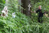 Anita Hawley checks to see if any damage was done to her angel statues in her backyard at her home in the 1900 block of Whippoorwill St. in Denton. Tree damage and downed power lines were reported in several areas of Denton County late Thursday night after winds approaching 55 mph hit the area.<div><br></div>DRC