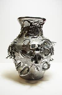 "This vessel by Brian Pierce, ""Flowers and Skulls,"" will be at the upcoming Enclave Eclectic 2, a pop-up art show from  6 to 9 p.m. on Friday, June 2 at the Walnut Street Annex of Agua Dulce Mexican Kitchen at 115 S. Elm St.  The show is presented by the Artists Enclave of Denton County.Artists Enclave of Denton County"