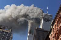 "<p><span style=""font-size: 1em; background-color: transparent;"">On Sept. 11, 2001, smoke rises from the burning Twin Towers of the World Trade Center after hijacked planes crashed into the towers in New York City.</span><br></p>AP file photo"