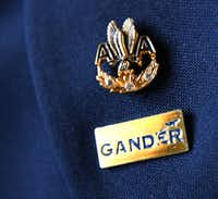 "<p><span style=""font-size: 1em; background-color: transparent;"">Beverley Bass never removed the Gander pin she received while stranded there following the Sept. 11 terrorist attacks. She kept it on her uniform lapel beneath her 30-year pin from American Airlines.</span><br></p>Dallas Morning News file photo"