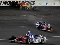 Ryan Hunter-Reay, top, and Carlos Munoz (14) wreck in Turn 3 as Conor Daly (4) drops down to avoid the accident during an Indy car race at Texas Motor Speedway on Saturday, June 10, 2017, in Fort Worth. (AP Photo/Larry Papke)AP